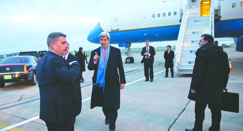 Secretary of State John Kerry (C) points to his vehicle after landing in Paris on Tuesday. Kerry was scheduled to meet Palestinian Authority President Mahmoud Abbas there on Wednesday. (REUTERS/Evan Vucci/Pool)