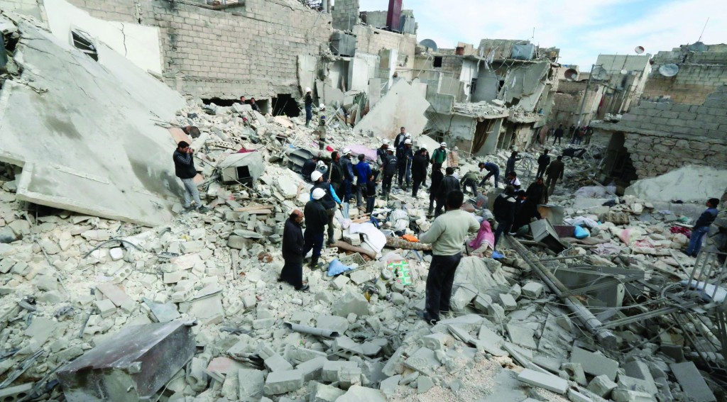 Residents inspect damage by what activists said were explosive barrels thrown by forces loyal to Syria's President Bashar al-Assad in the Tariq Al Bab neighbourhood of Aleppo Sunday. (REUTERS/Saad Abobrahim)