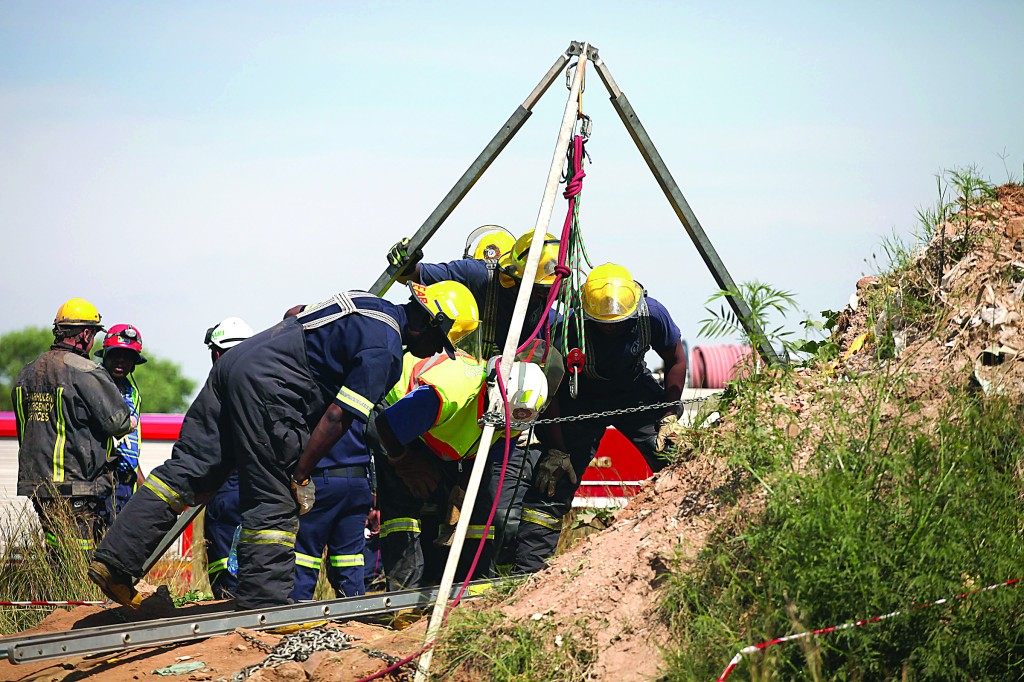 Emergency rescue workers attempt to free trapped illegal miners at a disused gold mine shaft near, Benoni, South Africa, Sunday (AP Photo)