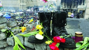 Military boots and flowers are seen at a make-shift memorial for those killed in recent violence in Kiev. (REUTERS/Konstantin Chernichkin)