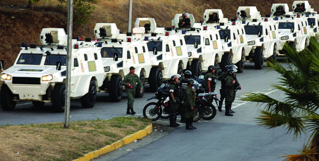 National Guard anti-riot vehicles wait in line during a protest against Nicolas Maduro's government in Caracas. (REUTERS/Christian Veron)