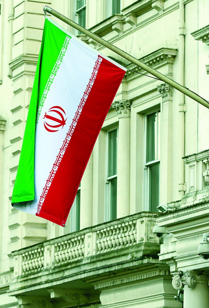 The national flag of the Peoples Islamic Republic of Iran flies outside its embassy in London. The embassy reopened its doors Thursday, more than two years after it was shut down over diplomatic tensions between the Islamic Republic and the United Kingdom. (AP Photo/Alastair Grant)