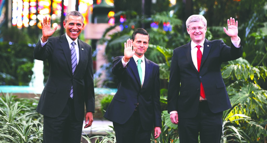 President Barack Obama joins Mexico's President Enrique Pena Nieto (C) and Canada's Prime Minister Stephen Harper (R) for a photograph at the start of the North American Leaders Summit at the Cosmovitralin Toluca, Mexico, on Wednesday. (REUTERS/Larry Downing)