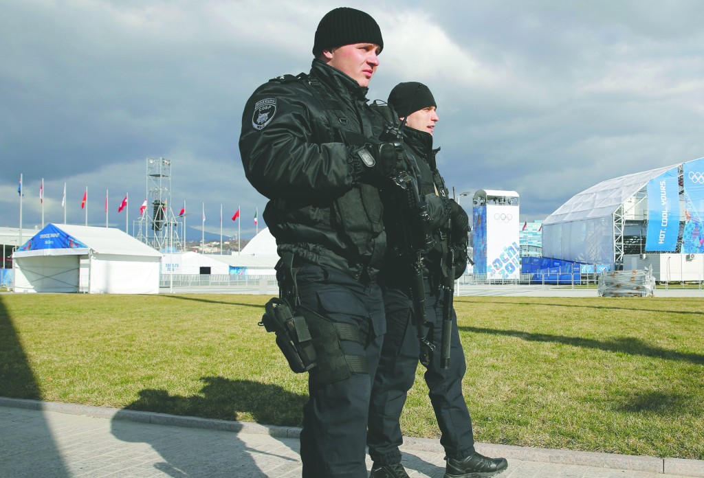 Russian security personnel patrol Olympic park ahead of the 2014 Winter Olympics, in Sochi, Russia. (AP Photo/Christophe Ena)