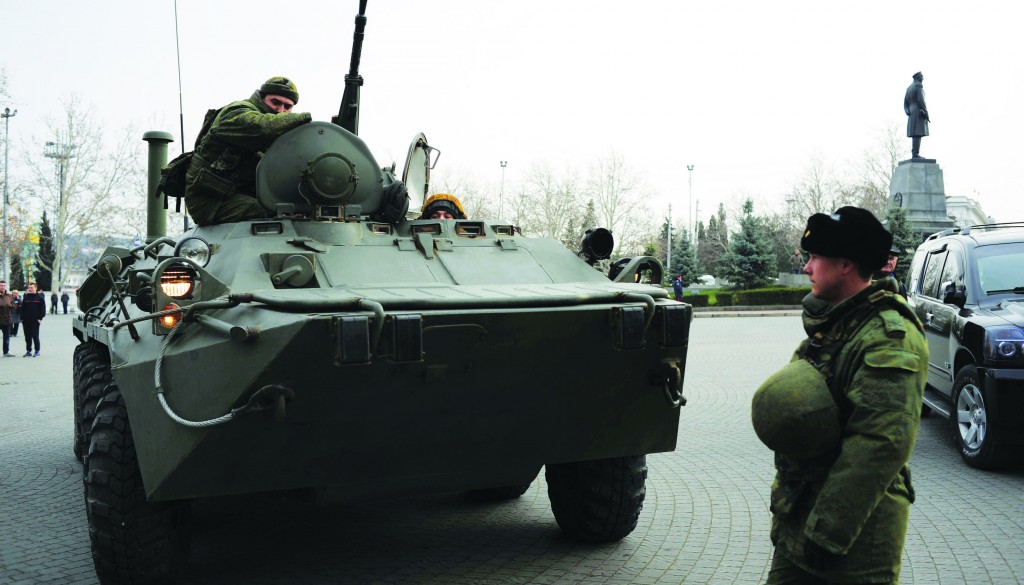 A Russian armored personnel carrier is driven on a street in Sevastopol, Ukraine's Black Sea Port that hosts a major Russian navy base, Tuesday. (AP Photo/Andrew Lubimov)