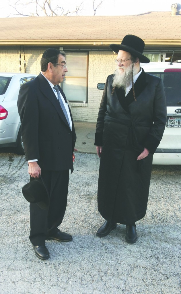 The Modzitzer Rebbe (R) speaking with Reb Zvi Ryzman from Los Angeles outside the DATA Community Kollel in Dallas.