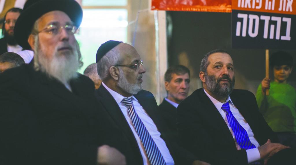 Shas party leader Aryeh Deri (R), MK Meshulam Nahari (C) and United Torah Judaism MK Rabbi Yisrael Eichler at the doctors' protest tent in Yerushalayim's Hadassah Ein-Kerem Hospital on Sunday. (Yonatan Sindel/Flash90)