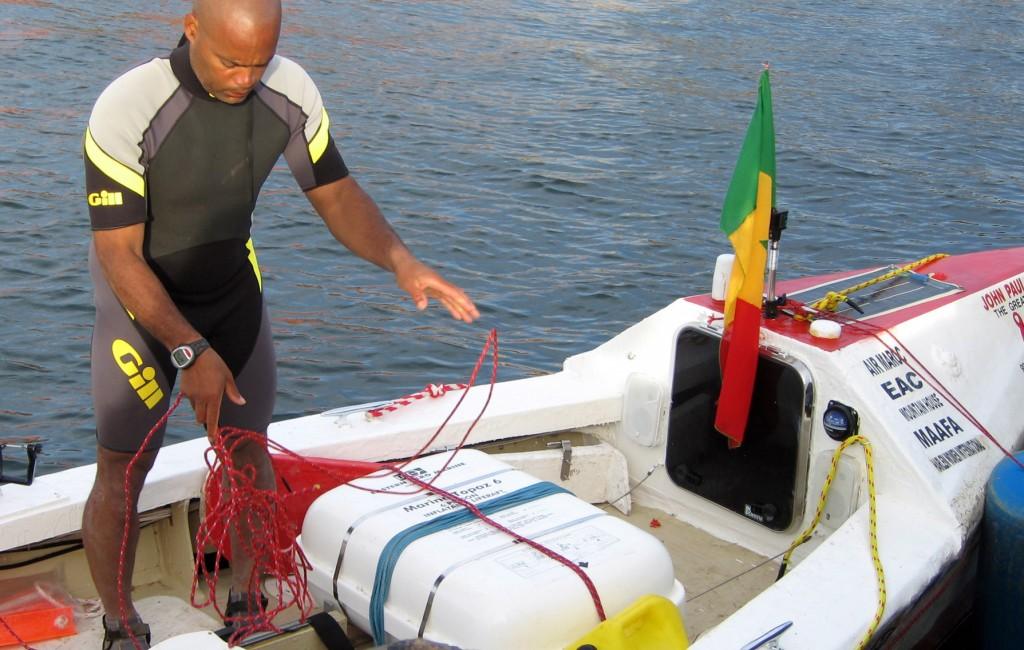 Victor Mooney prepares his rowboat for a transatlantic voyage in 2006. (AP Photo/Hilary Heuler)