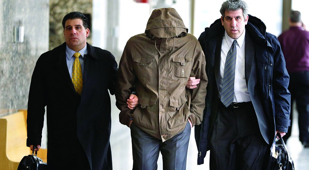 Wojciech Braszczok on Thursday is led into the Manhattan courtroom with his face covered. (AP Photo/Seth Wenig)