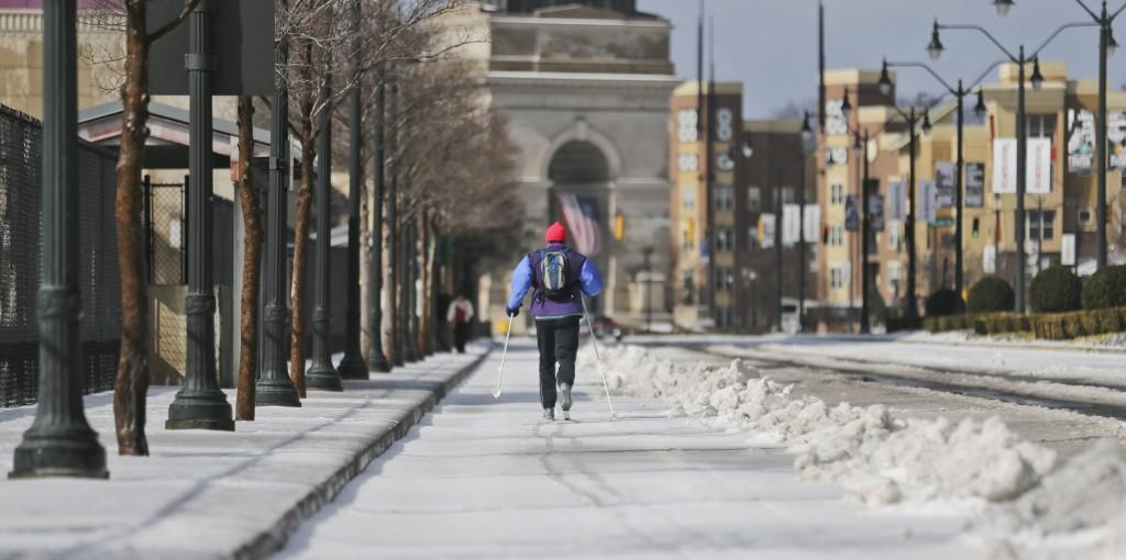 Jeff Ross-Bain cross-country skis from Piedmont Park across the 17th Street bridge past Atlantic Station, Thursday, Feb. 13, 2014, in Atlanta. (John Spink/Atlanta Journal-Constitution/MCT)
