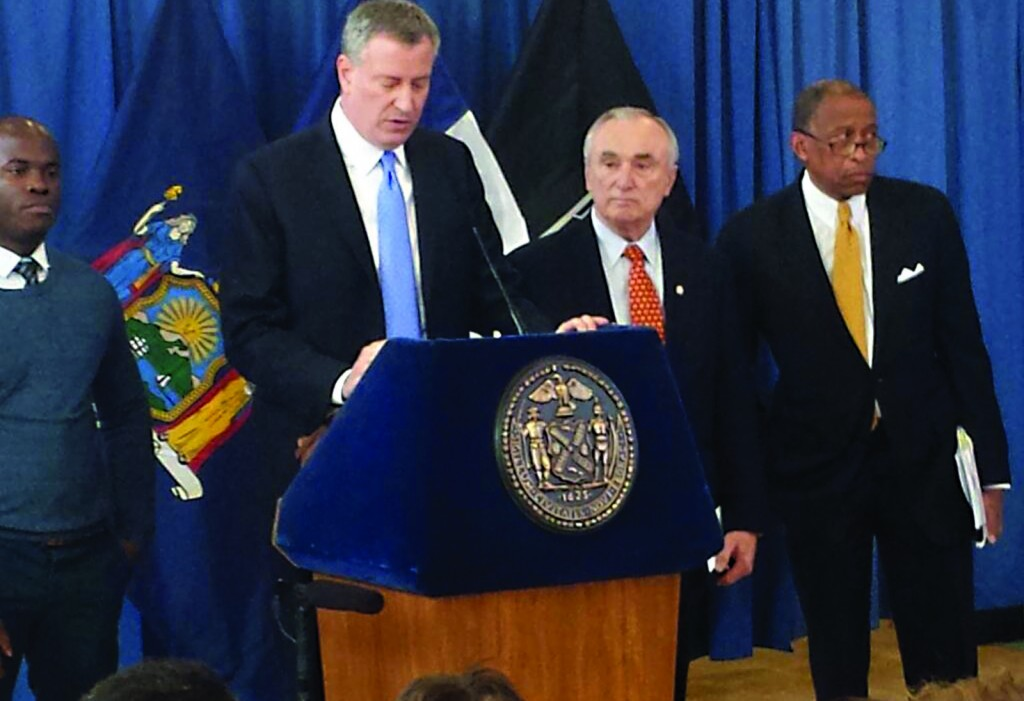 Police Commissioner William Bratton stands at Mayor Bill de Blasio's left Thursday as the mayor announces the settlement of the long-running stop-question-and-frisk case. (NYPD Photo)