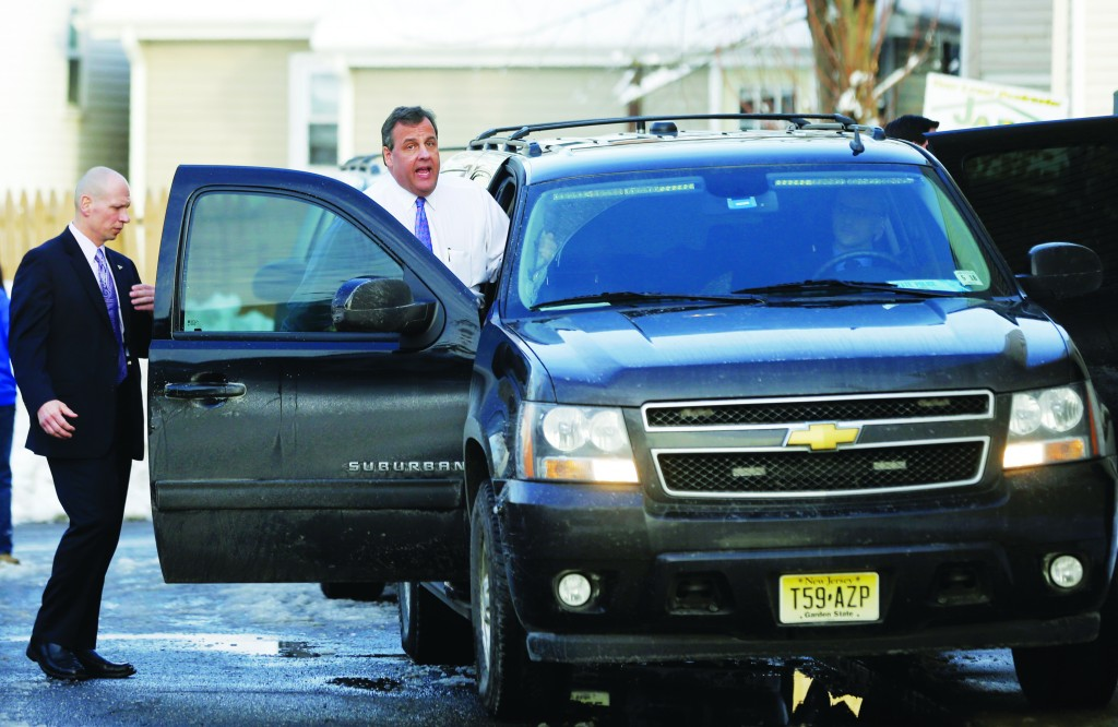 New Jersey Gov. Chris Christie (R) leaves a meeting Tuesday in Keansburg, N.J., with residents whose homes were heavily damaged by Superstorm Sandy. (AP Photo/Mel Evans)