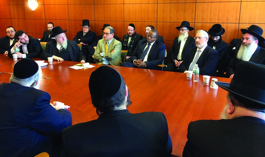 Brooklyn District Attorney Ken Thompson (center) meets Jewish community leaders on Sunday at his headquarters. (Gary Schlesinger)