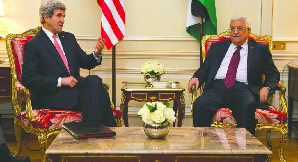 U.S. Secretary of State John Kerry (L) meets with Palestinian Authority President Mahmoud Abbas in Paris this week. (REUTERS/Evan Vucci/Pool)