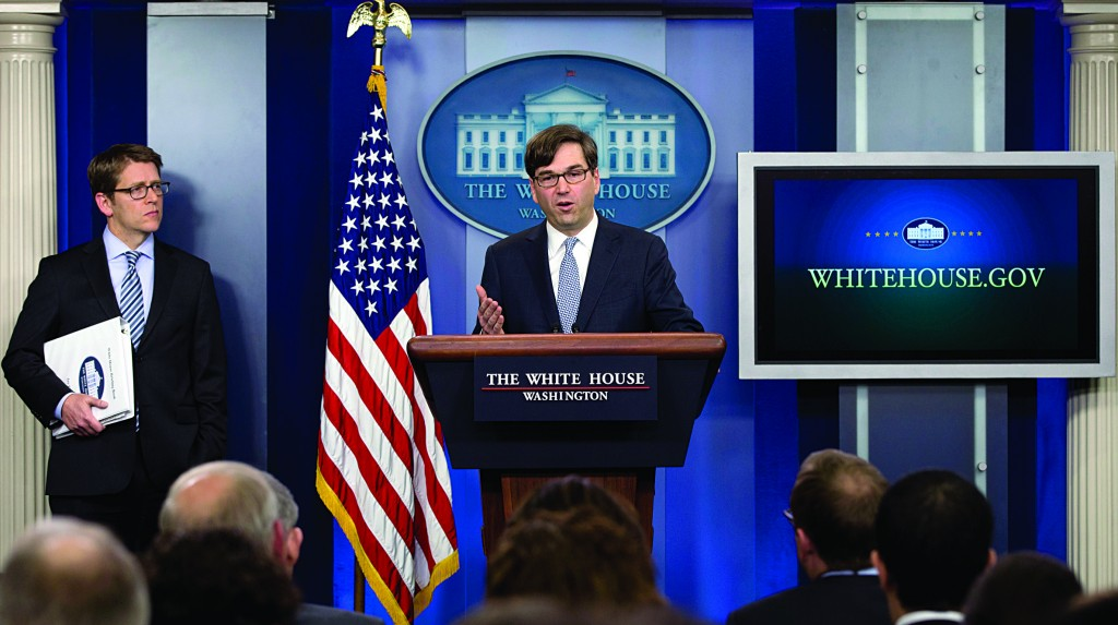 Chairman of the Council of Economic Advisers Jason Furman speaks, as White House press secretary Jay Carney stands left, during the daily news briefing at the White House, Tuesday, in Washington, about the Congressional Budget Office (CBO) report and the Affordable Care Act.  (AP Photo/Carolyn Kaster)