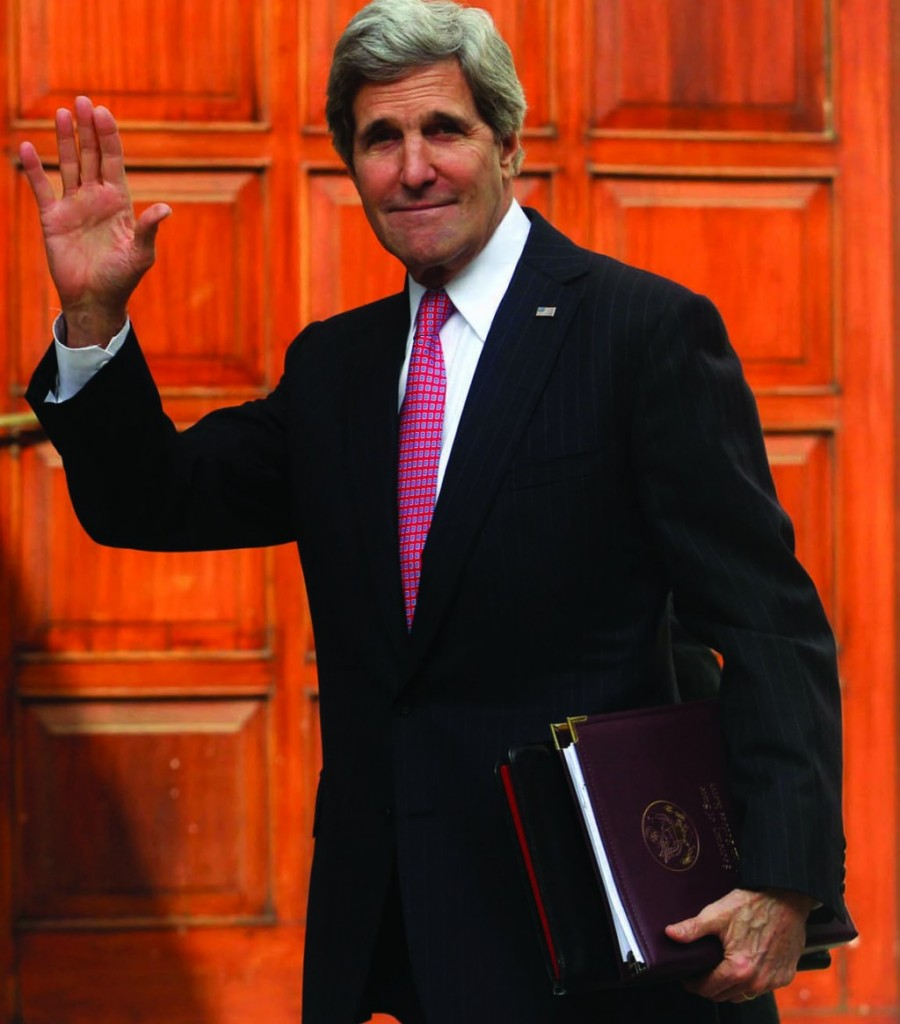 Secretary of State John Kerry waves upon arriving for a recent meeting with Palestinian Authority President Mahmoud Abbas in Ramallah.  (Issam Rimawi/Flash90)