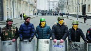 Protesters guard the entrance to Ukrainian President Yanukovych's office in Kiev Ukraine, Saturday. Ukrainian security and volunteers from among Independence Square protesters have joined forces to protect the presidential office from vandalism and marauding. (AP Photo/Efrem Lukatsky)