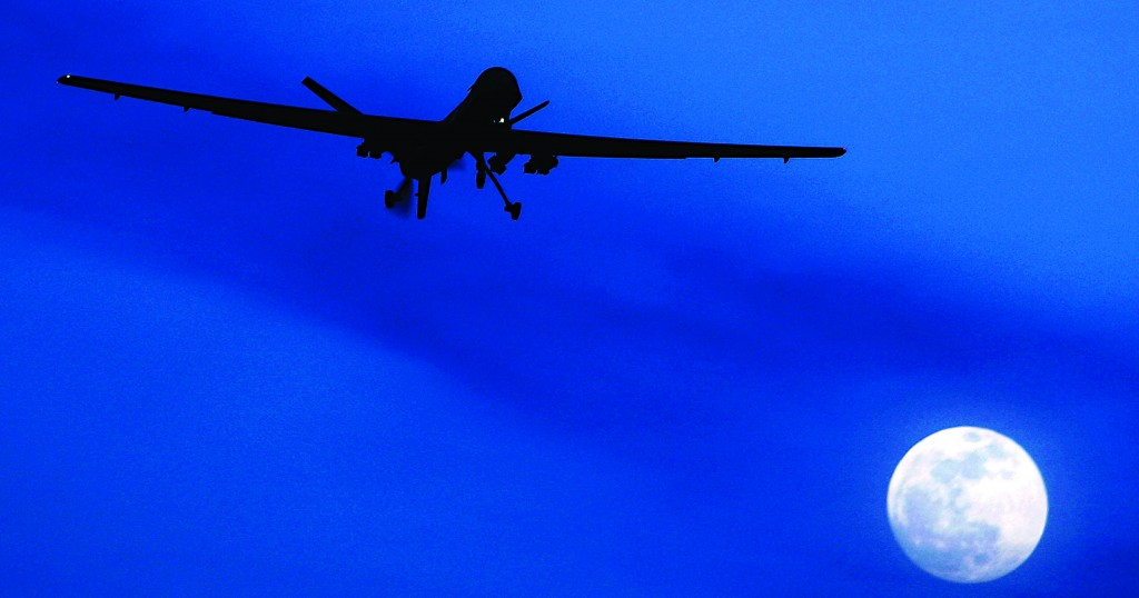 An unmanned U.S. Predator drone flies over Kandahar Air Field, southern Afghanistan, on a moon-lit night. (AP Photo/Kirsty Wigglesworth, File)