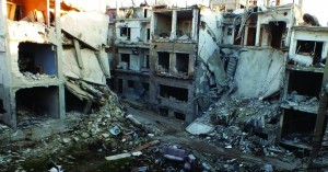 A street is seen lined with damaged buildings in the besieged area of Homs, Thursday. (REUTERS/Yazan Homsy)