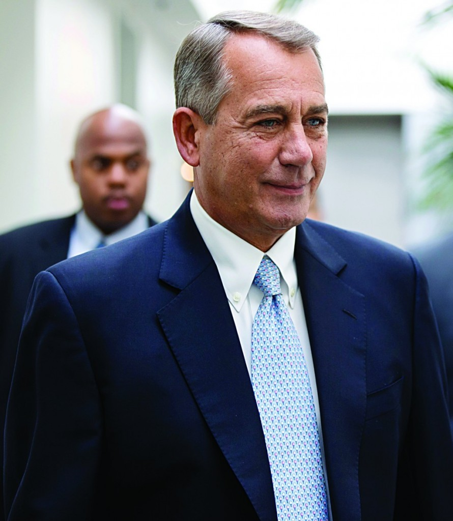 House Speaker John Boehner of Ohio smiles as walks to a strategy meeting with fellow Republicans before speaking to reporters about the Keystone XL Pipeline and other issues, Tuesday, on Capitol Hill in Washington. (AP Photo/J. Scott Applewhite)