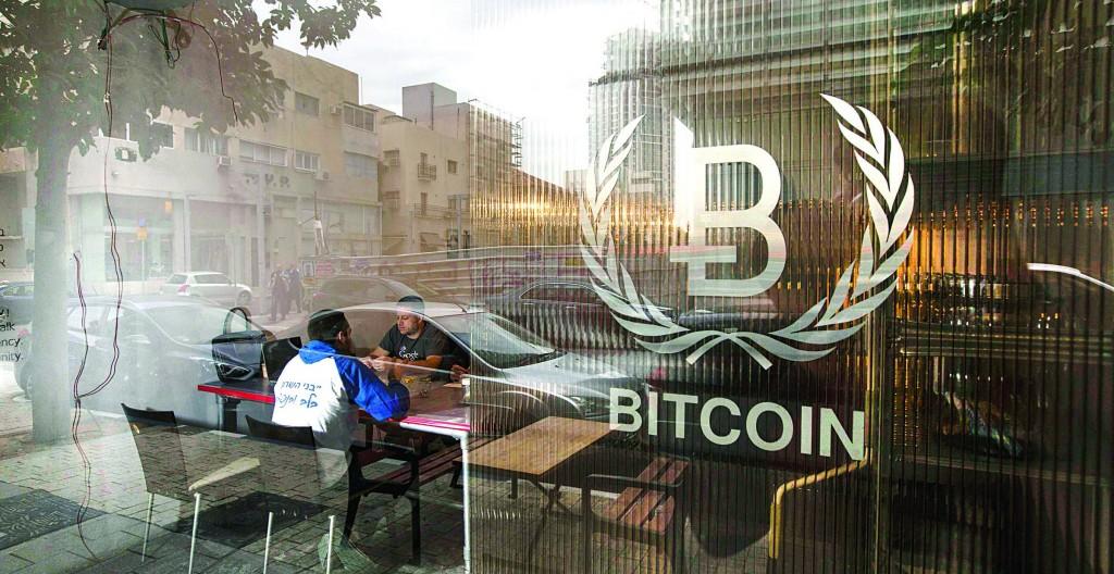 People sitting inside the Bitcoin Embassy in Tel Aviv. (REUTERS/Baz Ratner)