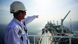 An officer points as he stands on a tanker carrying liquefied natural gas in the Mediterranean, six miles from the coastal Israeli city of Hadera, in January. The tanker Excellence is in a constant state of alert, waiting for the emergency phone call that Israel needs fuel. (REUTERS/Baz Ratner)