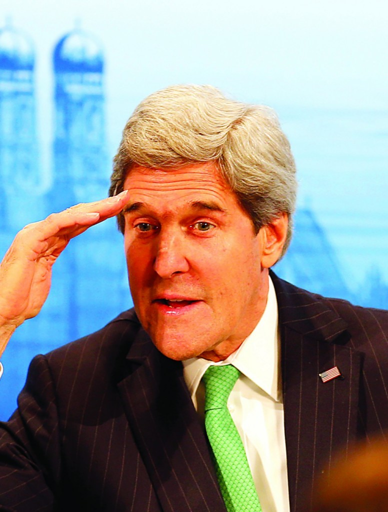 US Secretary of Foreign Affairs John Kerry salutes as he attends the 50th annual Security Conference in Munich, Germany, Saturday, Feb. 1, 2014. (AP Photo/Frank Augstein)