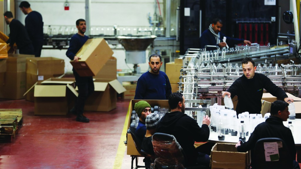 Palestinians working at a SodaStream factory in the Mishor Adumim industrial park, next to Maalei Adumim. The company manufactures a device for making carbonated drinks at home, has 25 factories around the world, and employs 800 Palestinians and 500 Israelis at the Mishor Adumim plant. (Nati Shohat/Flash90)