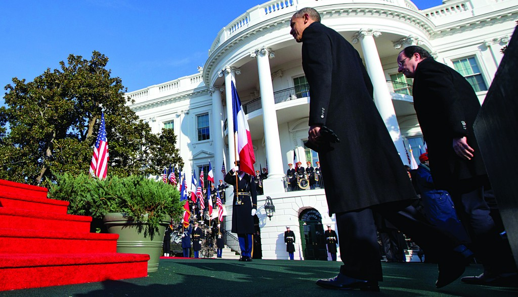 "President Barack Obama walks with French President Francois Hollande during a state arrival ceremony for Hollande, Tuesday, on the South Lawn of the White House. Lauding the ""enduring alliance"" between the two countries, President Obama welcomed President Hollande to the White House for a lavish state visit. (AP Photo/Jacquelyn Martin)"