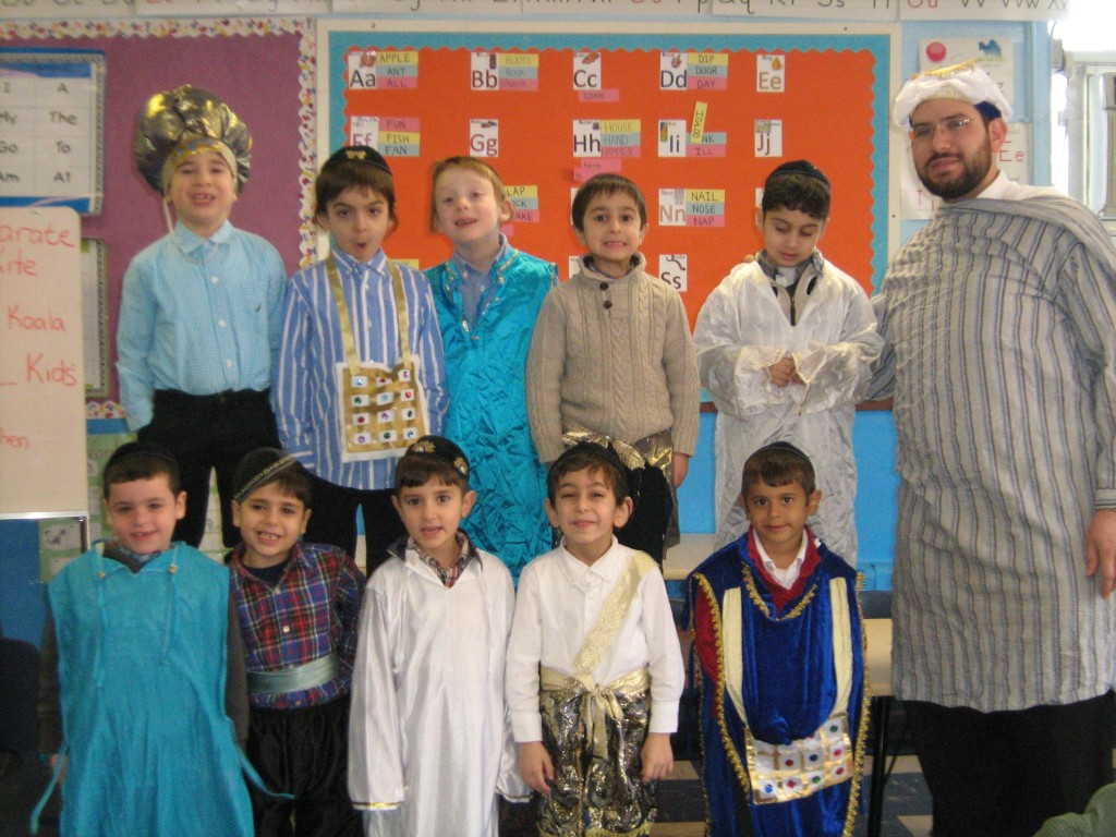 Rabbi Ezra Netanel of Yeshivat Mekor Haim in Brooklyn, Thursday, with his Pre-1A class wearing costumes based on the clothing of the Kohen Gadol.