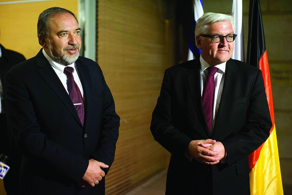 German Foreign Minister Frank-Walter Steinmeier (R) greeted by Israeli FM Avigdor Lieberman.  (Yonatan Sindel/Flash90)