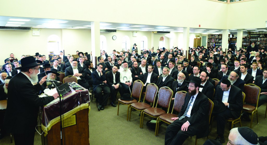 """Harav Meir Platnick, a R""""M at Yeshivah Derech Chaim, delivering a hesped on Sunday in conjunction with the end of shivah for Harav Mordechai Rennert, zt""""l, Rosh Yeshivah, Yeshiva Derech Chaim, at the yeshivah in Boro Park. (Refoel Yaakov Langsam)"""