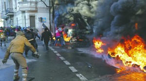 Protesters set barricades as vehicles burn during clashes with police in Kiev Tuesday. (REUTERS/Konstantin Chernichkin)