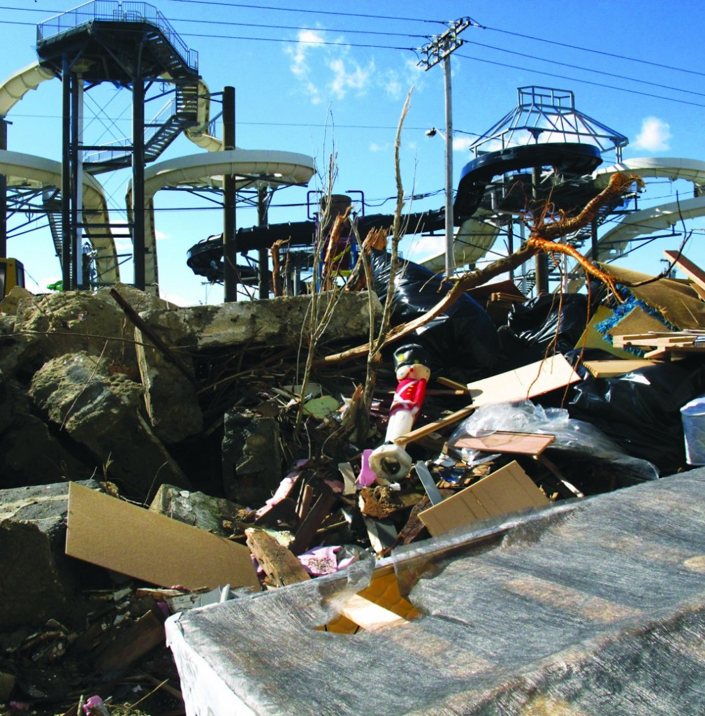 Rubble stands Monday in front of the Funland amusement park in Keansburg N.J. that was damaged in Superstorm Sandy. (AP Photo/Wayne Parry)