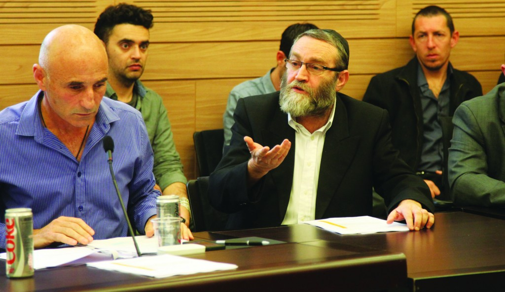 United Torah Judaism MK Rabbi Moshe Gafni (C) speaking at the Shaked Committee meeting on IDF army conscription on Monday. (Isaac Harari/ FLASH90 )