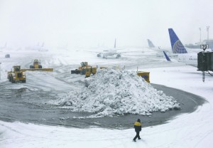 Plows on Monday clear runways at Newark Liberty Airport. (AP Photo/Kiichiro Sato)