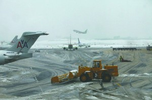 A tractor on Monday removes snow from the tarmac at LaGuardia Airport. (Reuters/Joshua Lott)