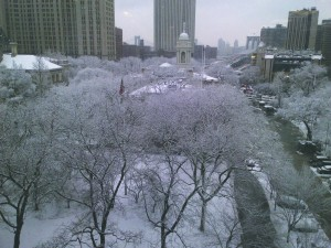 New York's City Hall and Brooklyn Bridge are enveloped in snow Monday. (Pinny Ringel)