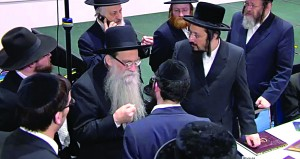 Harav Yeruchim Olshin, Rosh Yeshivah of Beis Medrash Govoha in Lakewood, speaking to Rabbi Rosen and others.