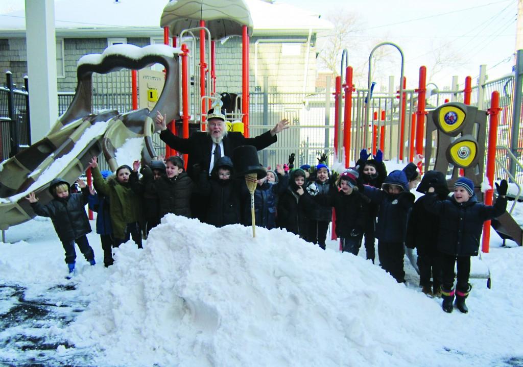 Rabbi Yankel Pilchick's Pre-1A class at Yeshiva Tiferes Yisroel of Flatbush are enjoying the snow in their park. (Yeshiva Tiferes Yisroel)