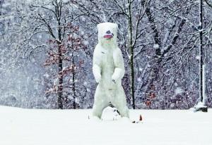 Snow covers a life-sized polar bear statue in Cherry Hill, N.J., Monday. (AP Photo/The Philadelphia Inquirer, David M Warren)