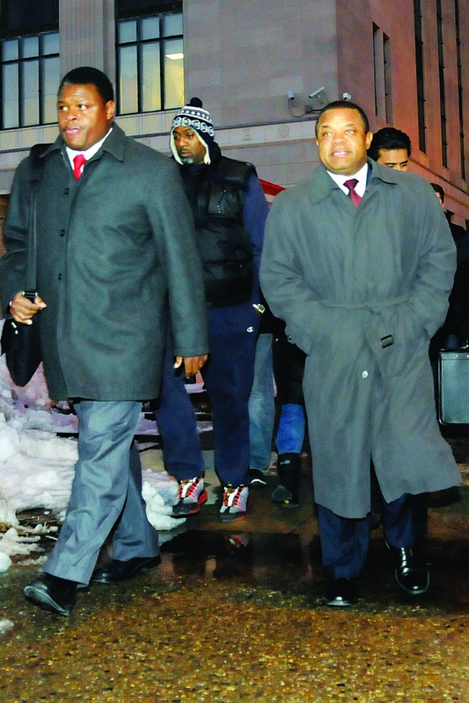 Trenton Mayor Tony Mack (R) accompanied by his brother, Ralphiel Mack (L), leaves Federal Court in Trenton Friday. (AP Photo/The Trentonian, Jackie Schear)