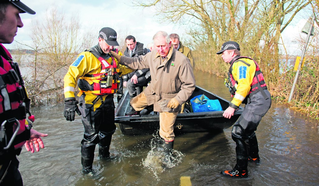 Britain's Prince Charles is assisted by police officers as he gets off a boat upon arriving in Muchelney, England, which is underwater along with other towns in the southwest.  Facing its wettest weather since 1766, England has been battered repeatedly by storms, inundating some parts of the country for more than a month. The River Thames overflowed its banks, flooding riverside towns upstream of London. With more rain due, river levels are projected to keep rising, overwhelming roads, rail lines, yards and even cemeteries. (Reuters)