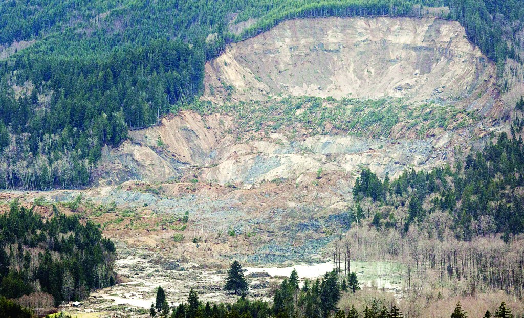 In this aerial photo taken Saturday, March 23, 2014, a massive mudslide is shown in between the towns of Darrington, Wash., and Arlington, Wash. (The Seattle Times, Marcus Yam)