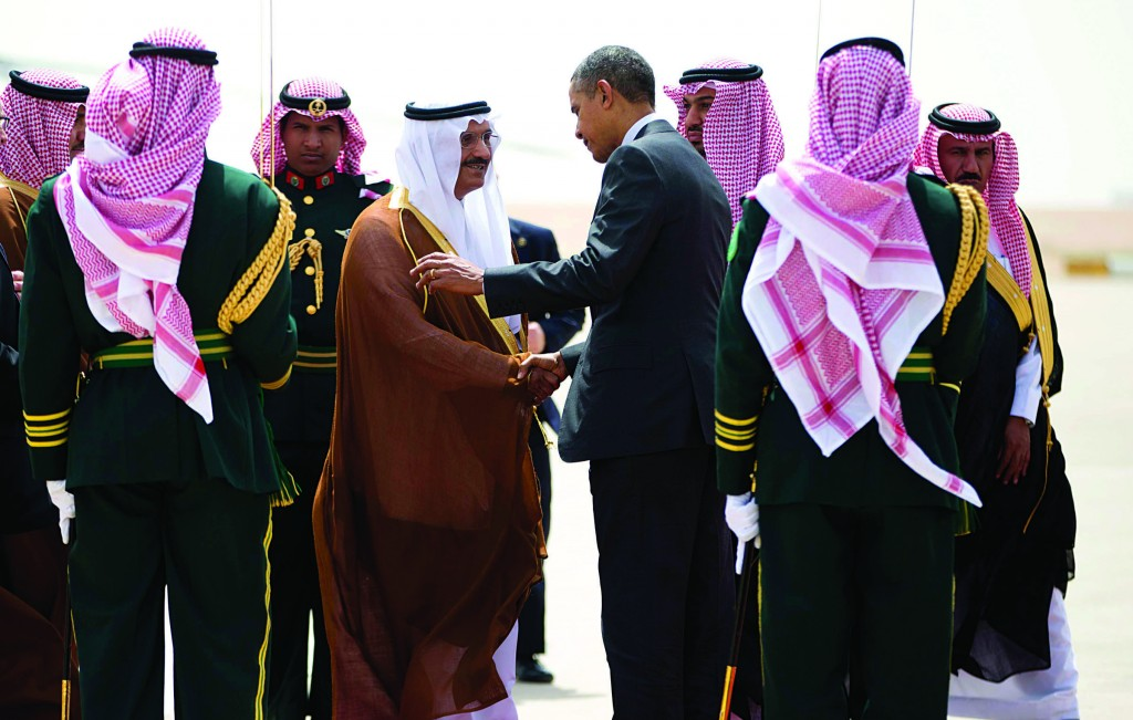 President Barack Obama shakes hands with Governor of Riyadh Prince Khalid Bandar bin Abdul-Aziz Al-Saud (C), during his departure on Air Force One at King Khalid International airport in Riyadh, Saudi Arabia, on Saturday. (AP Photo/Pablo Martinez Monsivais)