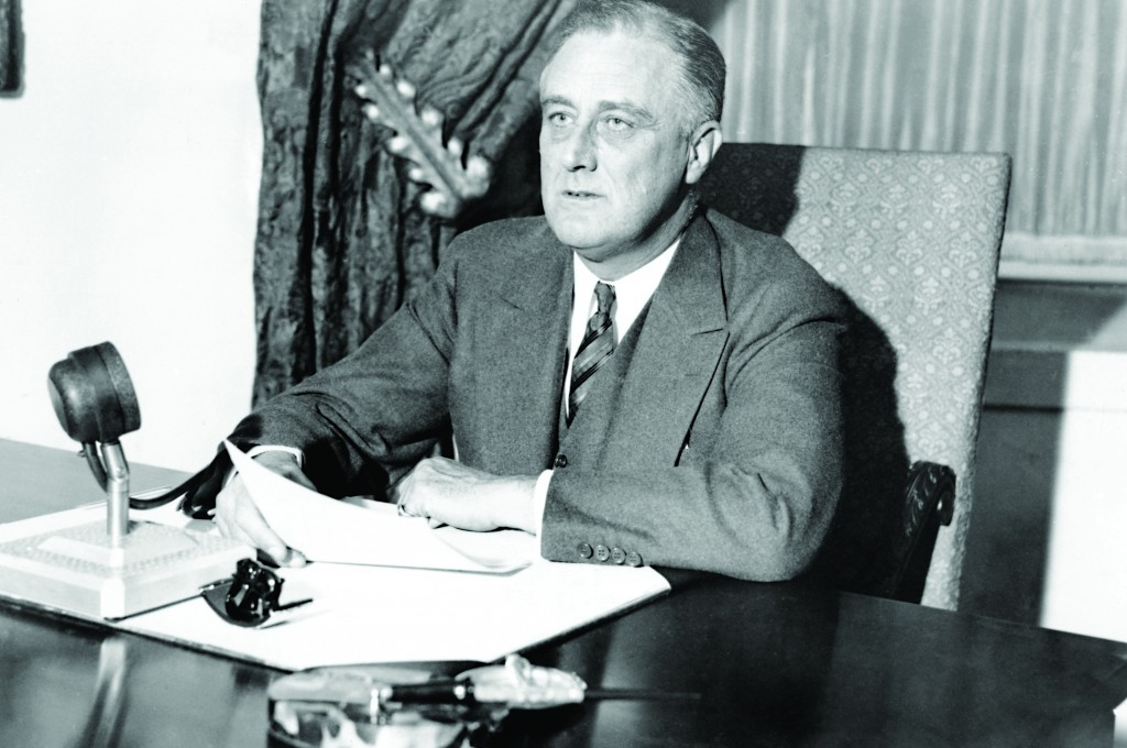 American President Franklin D. Roosevelt speaking to the people via radio, from the Executive Mansion, in Washington, DC, on March 12, 1933. The President asked for renewed confidence and faith by the people, telling them what had been done to ease the economic situation. The talk came on the eve of the reopening of the nations banks.  (AP Photo)