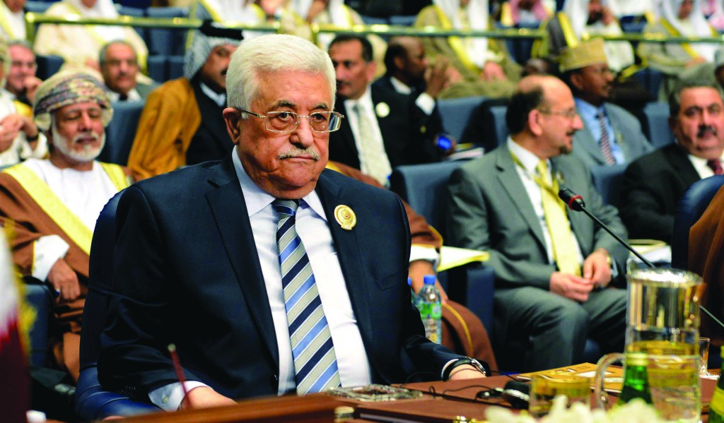 Palestinian Authority President Mahmoud Abbas attends the closing session of the Arab League Summit at Bayan Palace, Kuwait, on Wednesday. (AP Photo/Nasser Waggi)