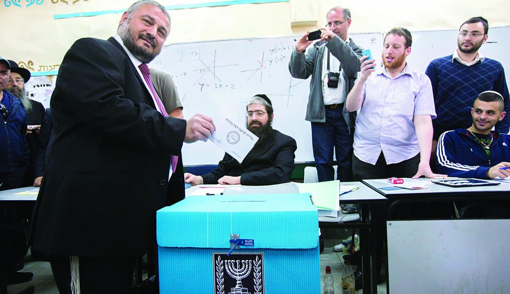 Mayor Moshe Abutbul casts his votes in the mayoral election in Beit Shemesh which he won in a hard-fought battle.