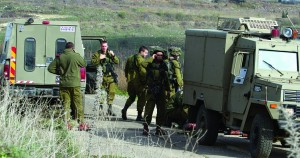 Israeli soldiers at the scene of a roadside bomb explosion near the Druze village of Majdal Shams in the Golan Heights on Tuesday. (Hamad Almakt/FLASH90)
