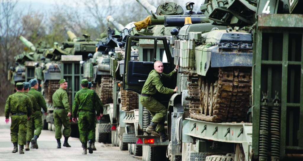 Ukrainian soldiers transport their tanks from their base in Crimea on Wednesday. (AP Photo/Pavel Golovkin)